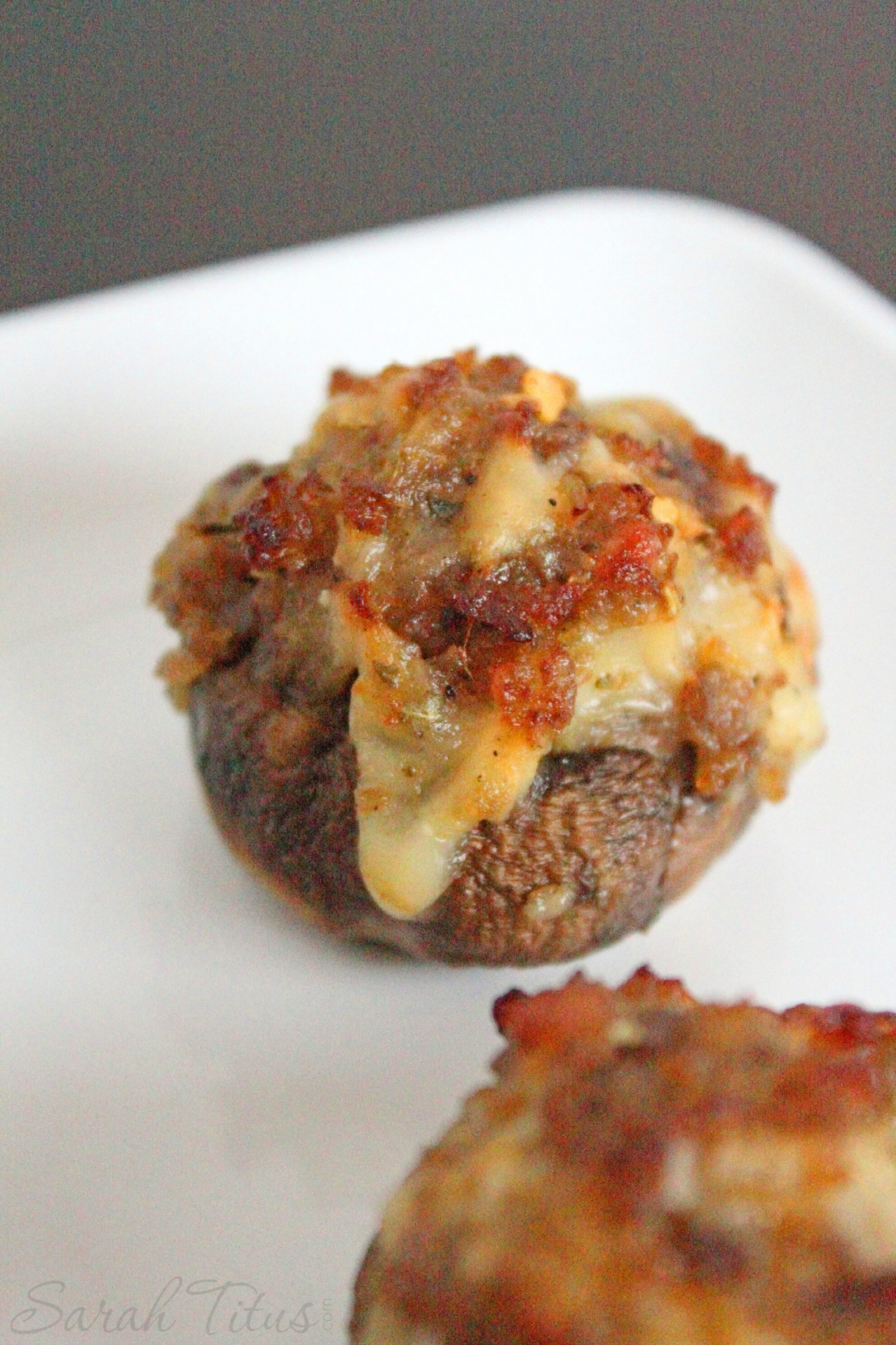 The delicious looking cooked Bite Size Stuffed Mushrooms with Sausage and Arugula