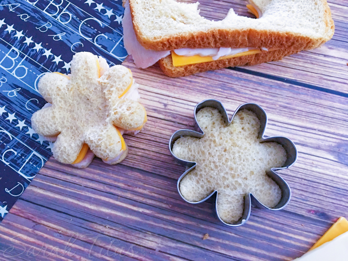The finished little flowered shaped cookie cutter turkey and cheese sandwiches