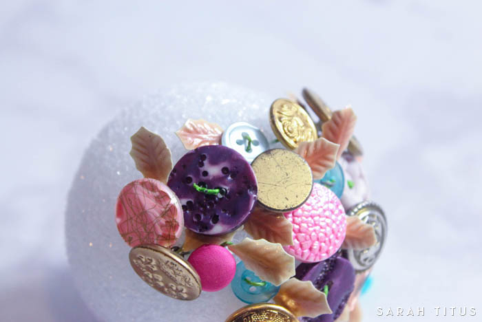 Don't know what to do with all those extra buttons you have laying around? Make a button Christmas tree ornament for the holidays!